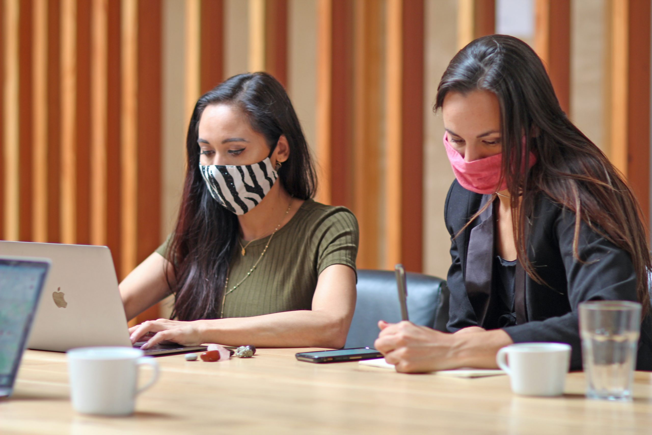 girls with masks beside each other
