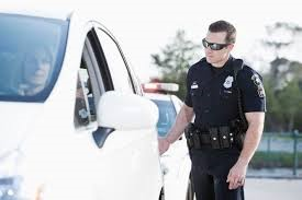 police officer approaching a vehicle