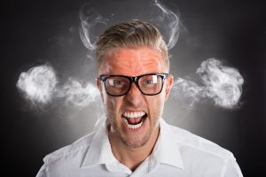 angry man with smoke coming from ears