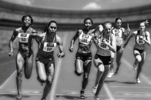 women in a relay race, passing batons